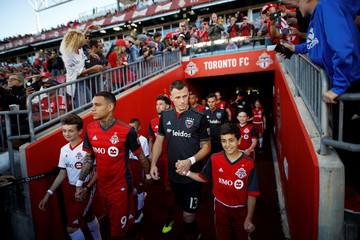 Players from Toronto FC and D.C. United lead kids to the field before playing in their MLS soccer match, at BMO Field, a venue for the 2026 FIFA World Cup, in Toronto
