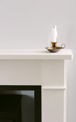 Candle on a stone mantlepiece