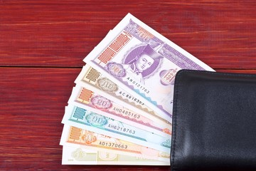 Money from Mongolia in the black wallet