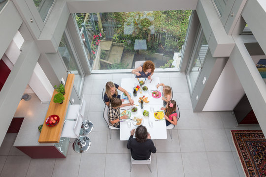Elevated view of a family at lunch in a modern home.