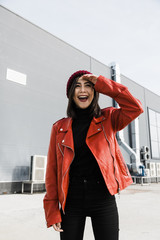 Smiling teenager wearing a red leather jacket and hat
