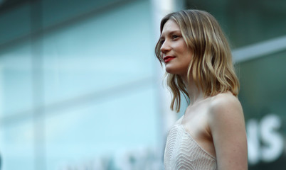 """Cast member Wasikowska poses at the premiere for the movie """"Damsel"""" in Los Angeles"""