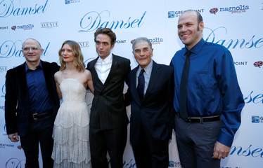 """Directors Nathan and David Zellner pose with cast members Wasikowska, Pattinson and Forster at the premiere for the movie """"Damsel"""" in Los Angeles"""