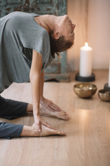 Woman stretching and meditating at home