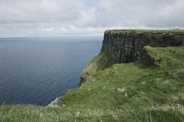 Expansive view of shoreline from the Cliffs of Moher, Ireland