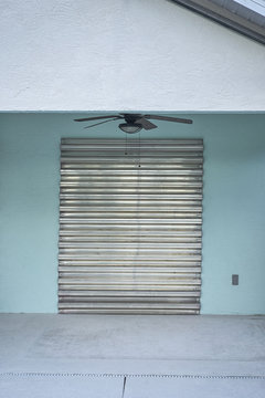 Hurricane Shutters on Concrete Home in Florida Before the Storm