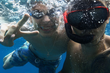 Friends having fun underwater