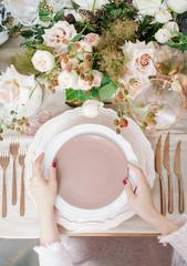 Crop woman serving plates