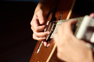 Guitarist playing the melody.