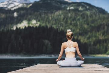 Woman Meditating on Lake