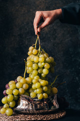 Hand holding fresh juicy grape