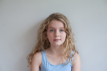 Portrait of a girl with blond curls