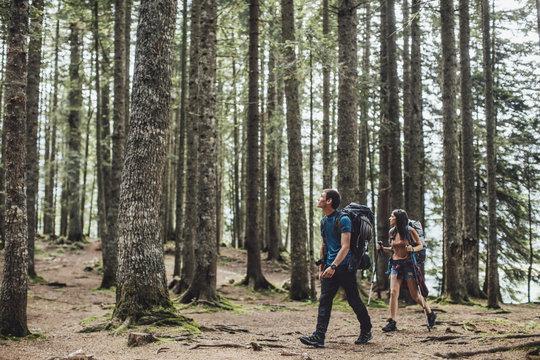 Couple Trekking in Woods