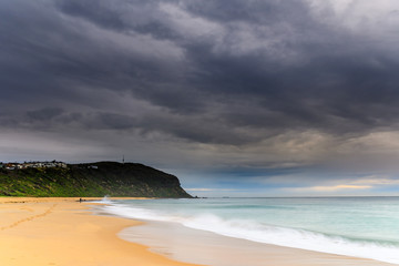 Overcast Morning Beach Scene with Headland