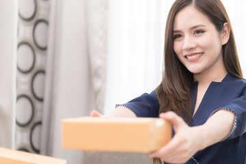 Woman is handing package box for mailing and shipment