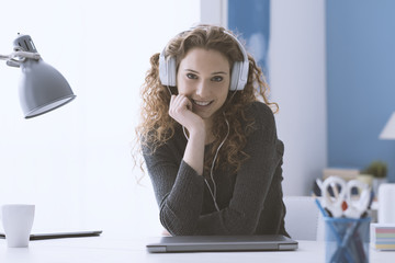 Happy smiling curly girl with headphones