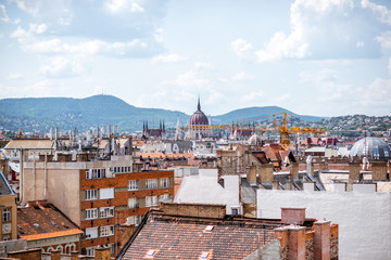 Top cityscape view with old residential buildings and dome of the famous Parliament building in Budapest, Hungary