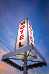 Vintage motel sign at sunset