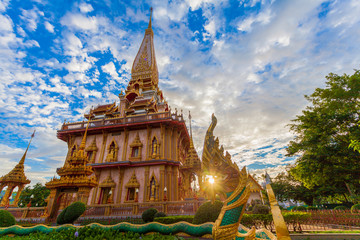 Foto auf Leinwand Tempel cloudy sunset above beautiful pagoda in Chalong temple Phuket Thailand
