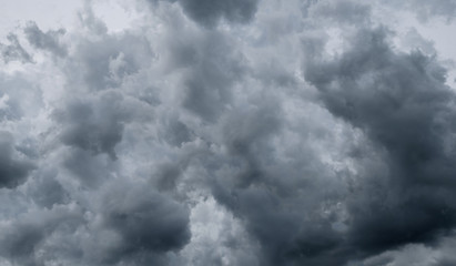 Dark storm clouds before rain used for climate background. Clouds become dark gray before raining. Dramatic background.