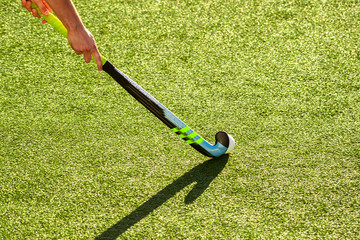 battle for control of ball during field hockey game