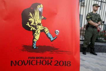 A poster by artist Yermolenko is seen during a rally demanding the boycott of the 2018 FIFA World Cup and the release of political prisoners held in Russia, in front of the Russian embassy in Kiev
