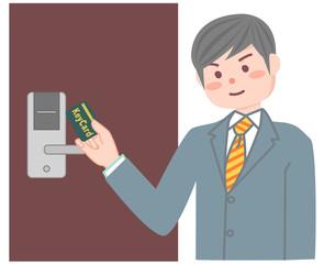 カードキーを使う男性