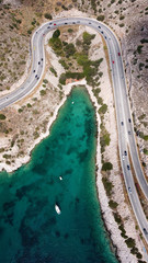 Aluminium Prints Dam Aerial drone bird's eye view photo of Tunnel in Athens riviera seaside road known as hole of Karamanlis, Attica, Greece