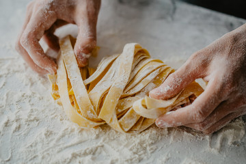 Fototapeta Chef making traditional italian homemade pasta