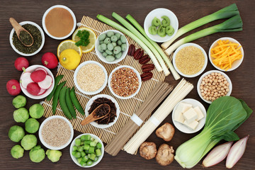 Macrobiotic diet food with japanese udon and sobu noodles, kuchika tea, tofu, miso and wasabi paste, legumes, grains and vegetables, foods high in protein, fibre, antioxidants, minerals and vitamins.