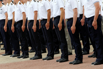 Members of a French Air Force graduating class stand at attention at the 721 Rochefort air base in Saint-Agnant