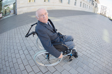 old man on wheelchair outdoors alone