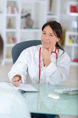 confident medical doctor portrait in office
