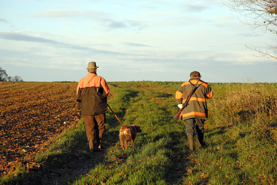 Department of Aisne. Big game hunting season (autumn). Hunters walking to the monitoring site.