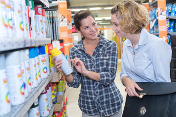 seller and client shopping for household detergents