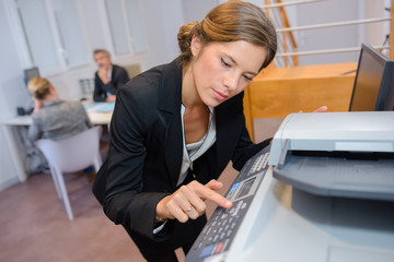secretary using photocopier in office