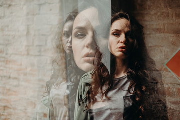 Double exposure. A curly-haired brunette is standing in the doorway of the theater. Poster events, personality psychology. Cloak and reincarnation. Fasting alcoholic fears. Bifurcation. Made in camera