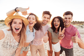 Group of happy young friends in summer clothes Wall mural