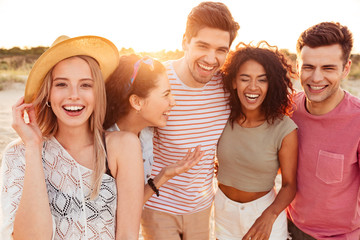 Group of joyful young friends in summer clothes
