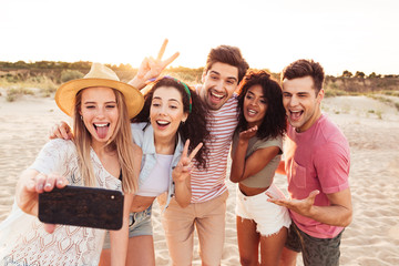 Group of happy young friends in summer clothes