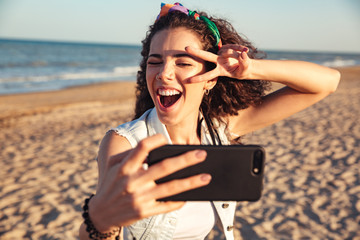 Excited young girl taking a selfie