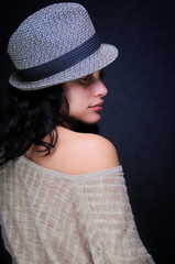 sensual girl with a hat and naked shoulder