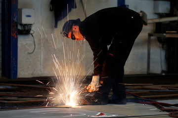 Sparks fly during the first steel cutting ceremony for the new MSC Meraviglia-Plus II, to be called the MSC Virtuosa at the STX shipyard site in Saint-Nazaire