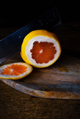 A knife in the middle of an orange.