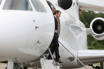 French President Emmanuel Macron disembarks a jet after landing at French Air Force base 721 Rochefort in Saint-Agnant