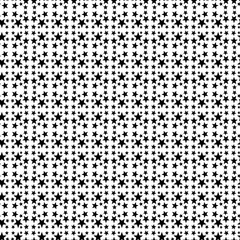 Seamless pattern with a black five-pointed little stras on a white background