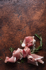 Prosciutto with rosemary .