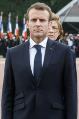 French President Emmanuel Macron and French Minister of the Armed Forces Florence Parly review troops during a visit at the French Air Force base 721 Rochefort in Saint-Agnant