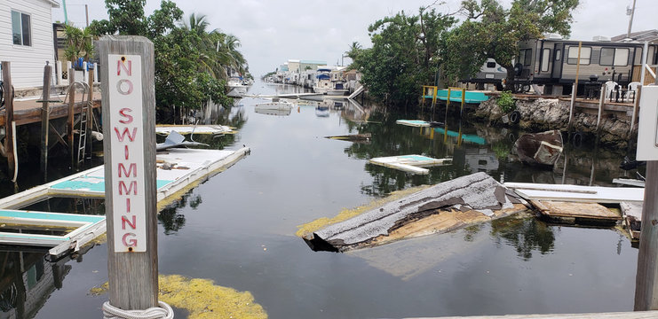 A debris-filled canal is seen, almost a year after Hurricane Irma, in Marathon