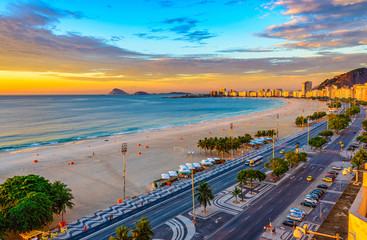 Sunrise view of Copacabana beach and Avenida Atlantica in Rio de Janeiro, Brazil